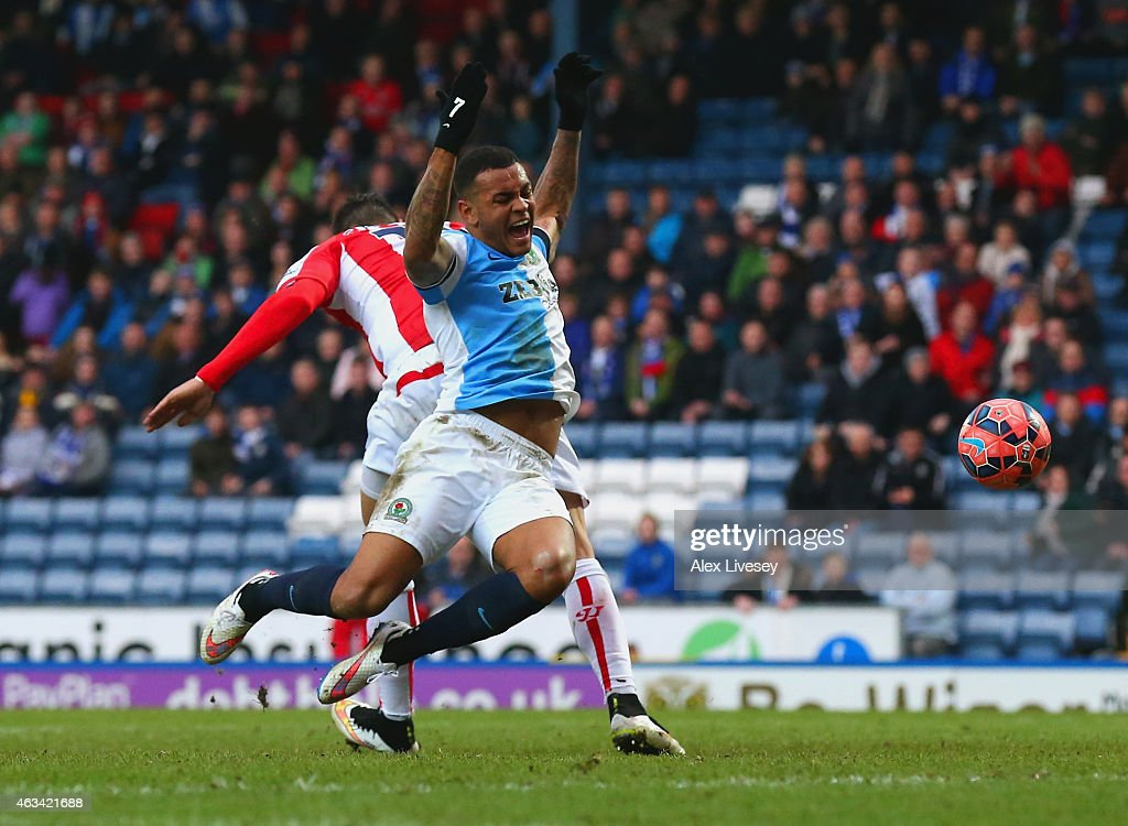 Joshua King of Blackburn is fouled by <a gi-track='captionPersonalityLinkClicked' href=/galleries/search?phrase=Geoff+Cameron&family=editorial&specificpeople=5101639 ng-click='$event.stopPropagation()'>Geoff Cameron</a> of Stoke City to win a penalty during the FA Cup Fifth Round match between Blackburn Rovers and Stoke City at Ewood park on February 14, 2015 in Blackburn, England.