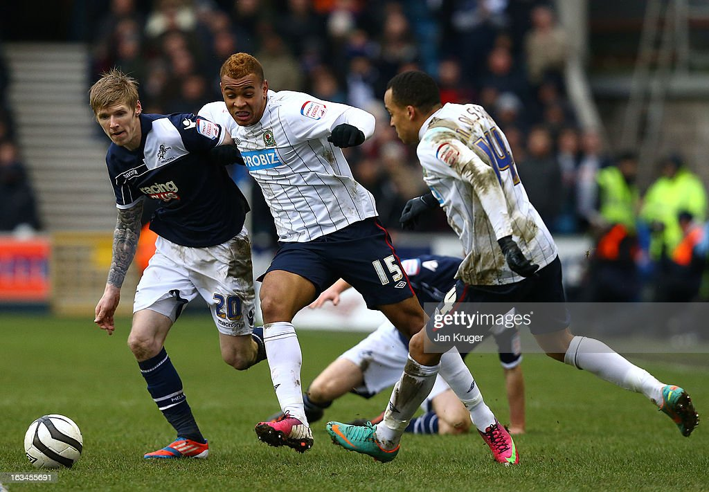 Joshua King of Blackburn Rovers battles with Andrew Keogh of Millwall during the FA Cup sponsored by Budweiser sixth round match between Millwall and Blackburn Rovers at The Den on March 10, 2013 in London, England.