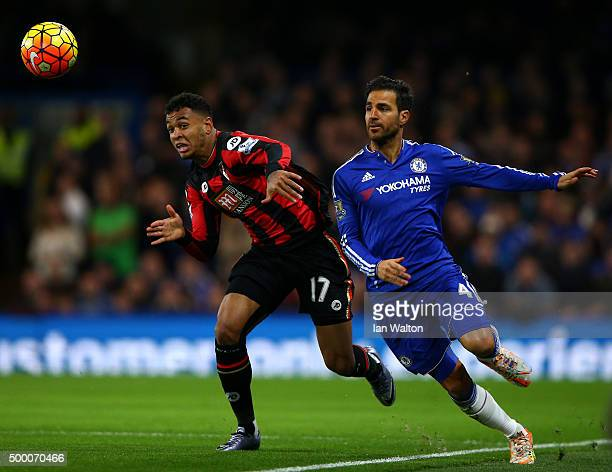 Joshua King of Bournemouth and Cesc Fabregas of Chelsea compete for the ball during the Barclays Premier League match between Chelsea and AFC...