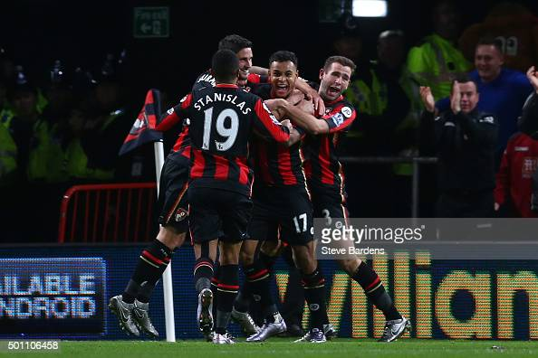 Joshua King of Bournemouth celebrates scoring his team's second goal with his team mates during the Barclays Premier League match between AFC...