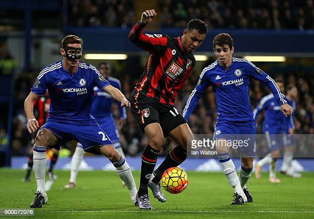 Joshua King of Bournemouth controls the ball under pressure of Nemanja Matic and Oscar of Chelsea during the Barclays Premier League match between...