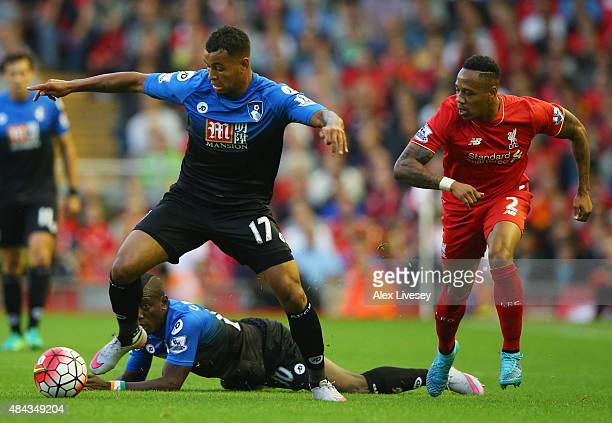 Joshua King of Bournemouth is chased by Nathaniel Clyne of Liverpool during the Barclays Premier League match between Liverpool and AFC Bournemouth...