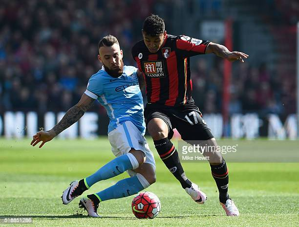 Joshua King of Bournemouth is tackled by Nicolas Otamendi of Manchester City during the Barclays Premier League match between AFC Bournemouth and...