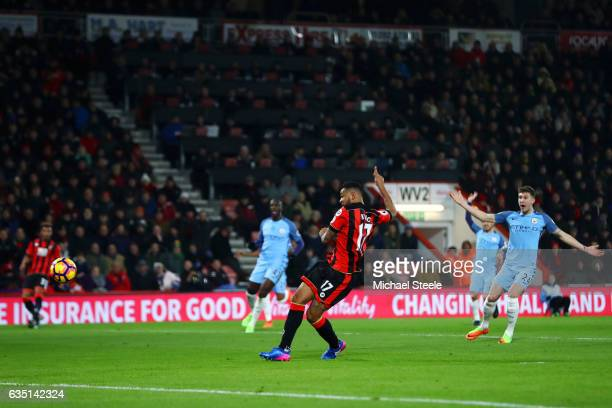 Joshua King of Bournemouth scores a disallowed goal after pulling on the shirt of John Stones of Manchester City on his run through during the...