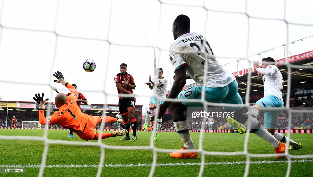 Joshua King of Bournemouth (partially obscured left) scores the winning goal past goalkeeper Darren Rudolph and Michail Antonio on the line during the Premier League match between AFC Bournemouth and West Ham United at Vitality Stadium on March 11, 2017 in Bournemouth, England.