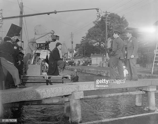 Joshua Logan beneath the camera directs James Garner as Capt Mike Bailey and Marlon Brando as Major Lloyd Gruver on location in Japan in Sayonara