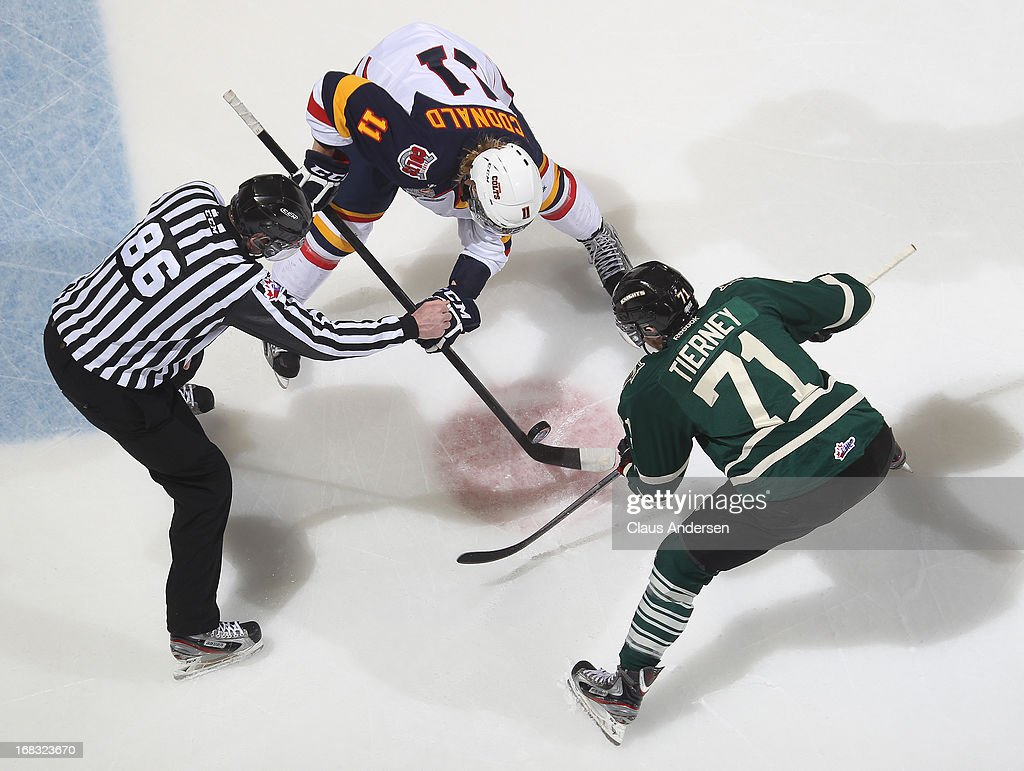 Joshua MacDonald #11 of the Barrie Colts takes a faceoff against Chris Tierney #71 of the London Knights in Game One of the OHL Championship Final on May 3, 2013 at the Budweiser Gardens in London, Ontario, Canada. The Colts defeated the Knights 4-2 to take a 1-0 series lead.