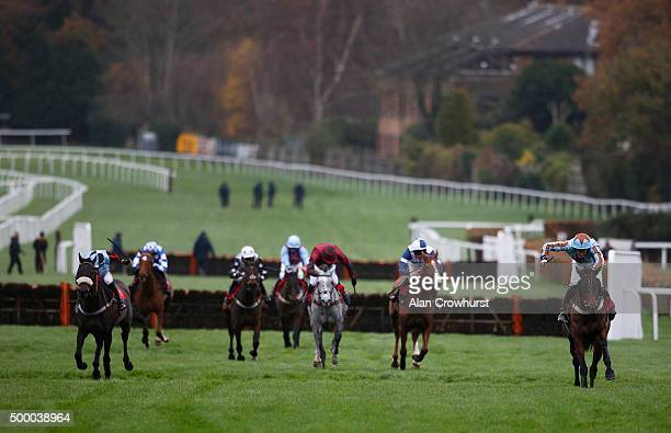 Joshua Moore riding Flute Bowl clear the last to win The thebookiesofferscouk Mares' Handicap Hurdle Race at Sandown racecourse on December 05 2015...