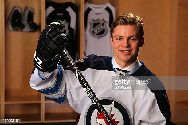 Joshua Morrissey 13th overall pick by the Winnipeg Jets poses for a portrait during the 2013 NHL Draft at Prudential Center on June 30 2013 in Newark...