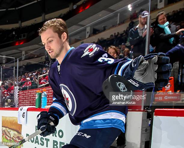 Joshua Morrissey of the Winnipeg Jets hits the ice for the pregame warm up prior to NHL action against the Montreal Canadiens at the MTS Centre on...