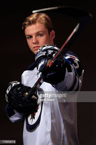 Joshua Morrissey poses for a portrait after being selected number thirteen overall in the first round by the Winnipeg Jets during the 2013 NHL Draft...