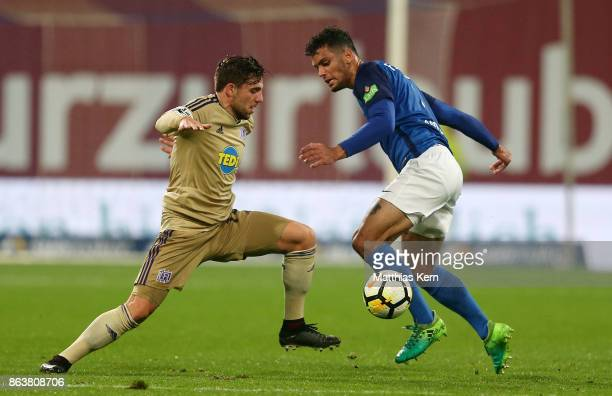 Joshua Nadeau of Rostock battles for the ball with Ahmet Metin Arslan of Osnabrueck during the third league match between FC Hansa Rostock and VfL...