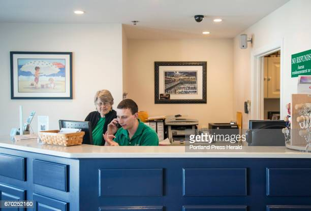 Joshua Oeullette helps a customer on the telephone while Sandra Kurkjy looks on at the front desk of Sea View on West Grand Avenue in Old Orchard...