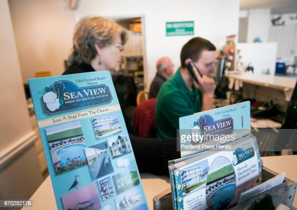 Joshua Oeullette right and Mike Longtin help customers on the telephone while Sandra Kurkjy looks on at the front desk of Sea View on West Grand...