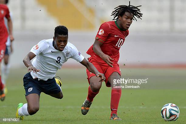Joshua Onomah of England is brought down by Renato Sanches of Portugal during the UEFA Under17 European Championship 2014 semi final match between...