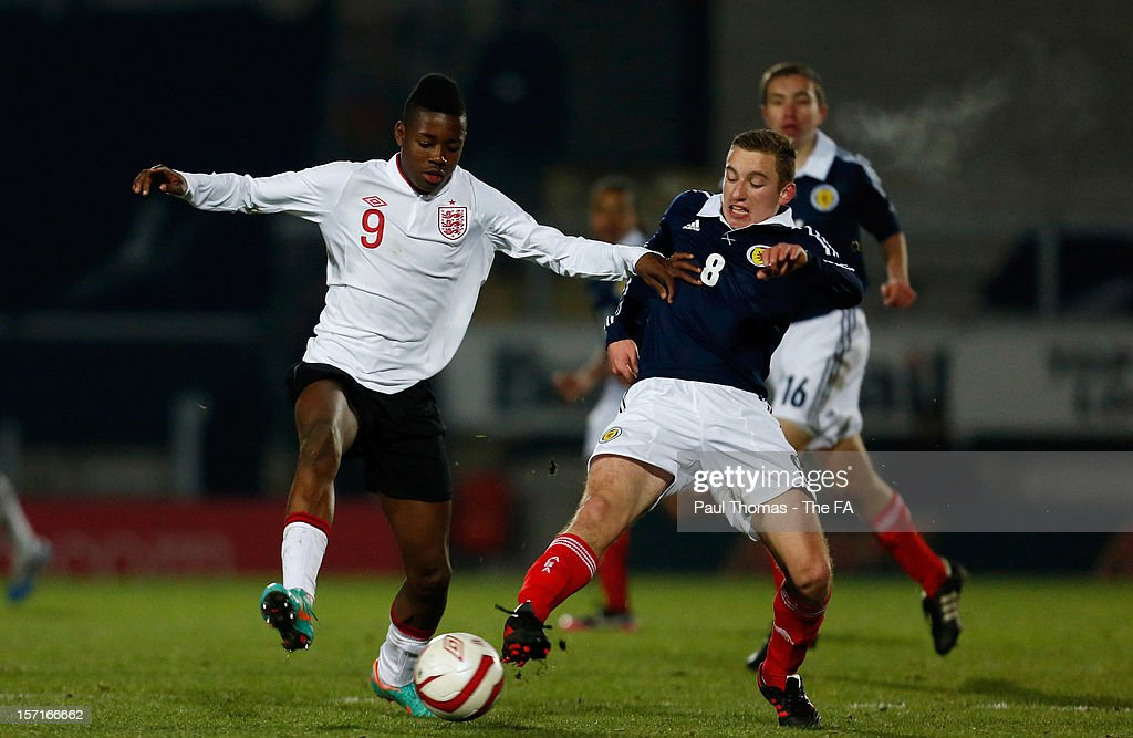 Joshua Onomah of England U16 (L) in action with Richie Petrie of Scotland U16 during the Sky Sports Victory Shield match between England U16 and Scotland U16 at Pirelli Stadium on November 29, 2012 in Burton-upon-Trent, England.