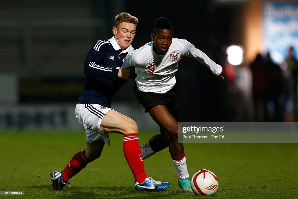 Joshua Onomah (R) of England U16 in action with Sam Wardrop of Scotland U16 during the Sky Sports Victory Shield match between England U16 and Scotland U16 at Pirelli Stadium on November 29, 2012 in Burton-upon-Trent, England.