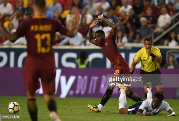 Joshua Onomah of Tottenham Hotspur lies on the ground as Gerson from AS Roma gestures during their International Champions Cup football match on July...