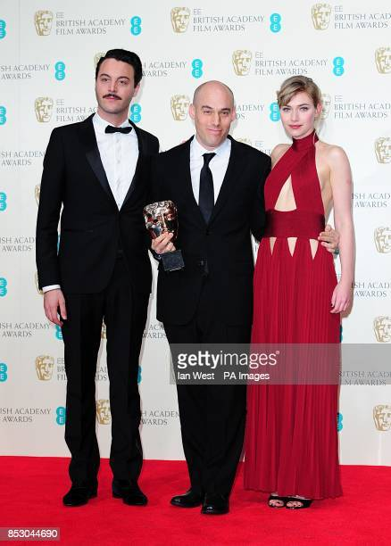 Joshua Oppenheimer with the Best Documentary award for 'The Act of Killing' alongside presenters Imogen Poots and Jack Huston at The EE British...