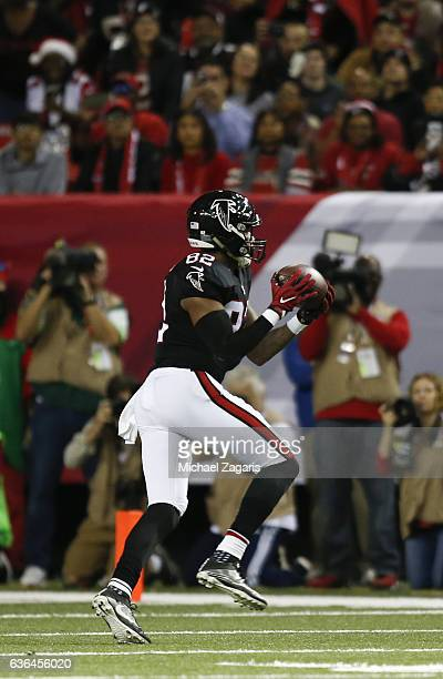 Joshua Perkins of the Atlanta Falcons makes a reception during the game against the San Francisco 49ers at the Georgia Dome on December 18 2016 in...