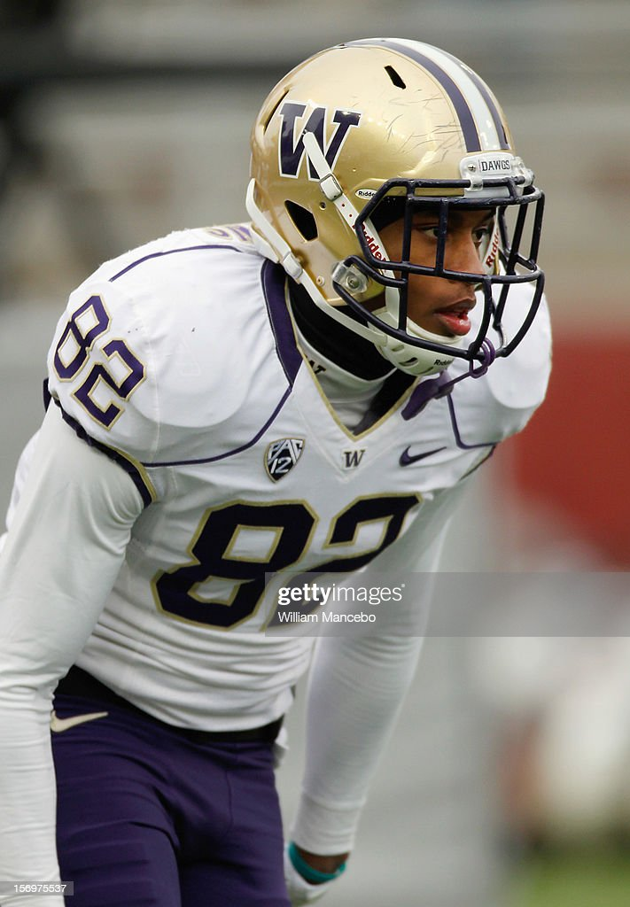 Joshua Perkins #82 of the Washington Huskies during warm ups prior to the start of the Apple Cup game against the Washington State Cougars at Martin Stadium on November 23, 2012 in Pullman, Washington.