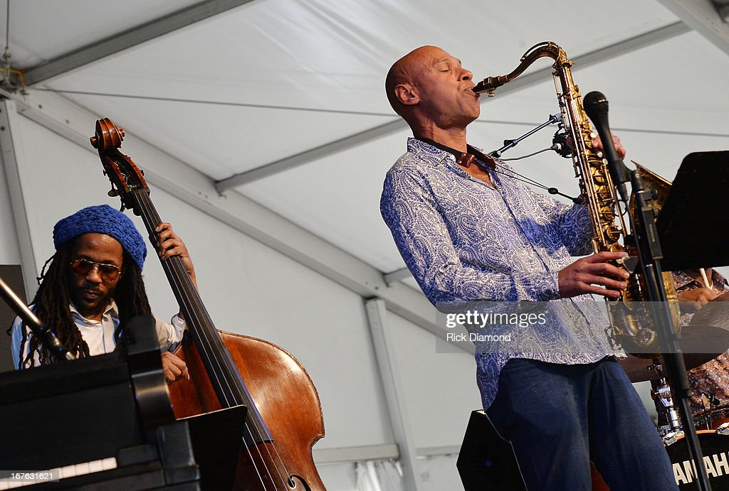 <a gi-track='captionPersonalityLinkClicked' href=/galleries/search?phrase=Joshua+Redman&family=editorial&specificpeople=1153320 ng-click='$event.stopPropagation()'>Joshua Redman</a> of <a gi-track='captionPersonalityLinkClicked' href=/galleries/search?phrase=Joshua+Redman&family=editorial&specificpeople=1153320 ng-click='$event.stopPropagation()'>Joshua Redman</a> Quartet with Joe Sanders (left) performs during the 2013 New Orleans Jazz & Heritage Music Festival presented by Shell at Fair Grounds Race Course on April 26, 2013 in New Orleans, Louisiana.