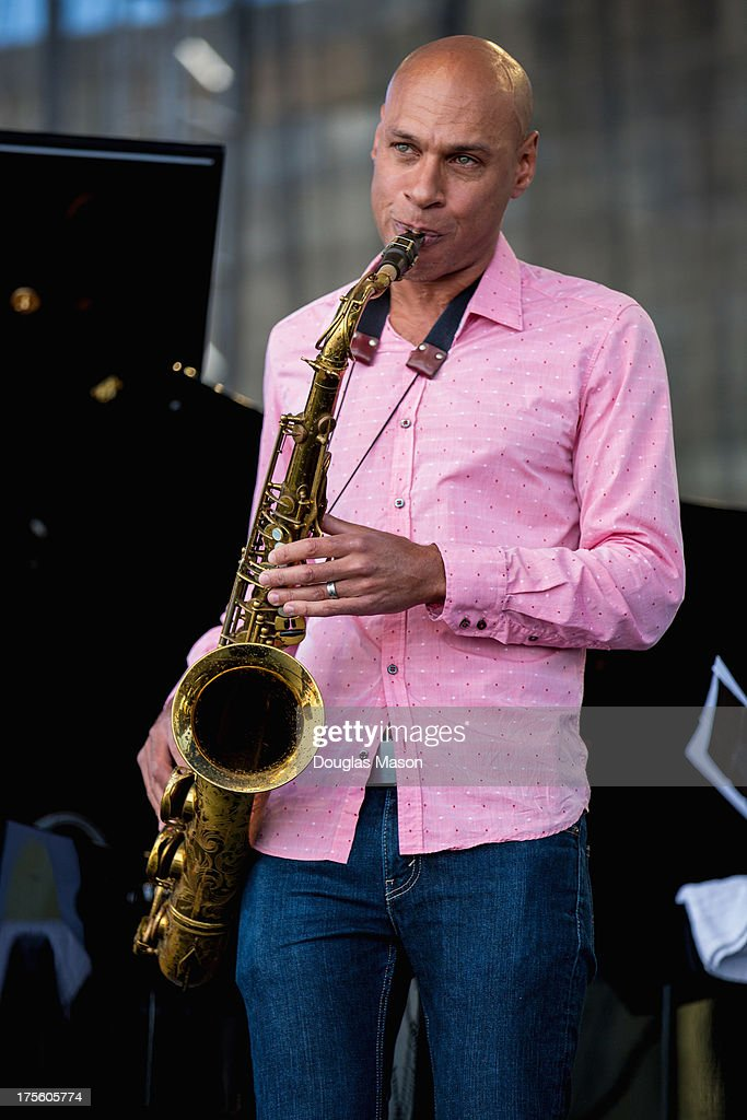 <a gi-track='captionPersonalityLinkClicked' href=/galleries/search?phrase=Joshua+Redman&family=editorial&specificpeople=1153320 ng-click='$event.stopPropagation()'>Joshua Redman</a> performs during the Newport Jazz Festival 2013 at Fort Adams State Park on August 4, 2013 in Newport, Rhode Island.