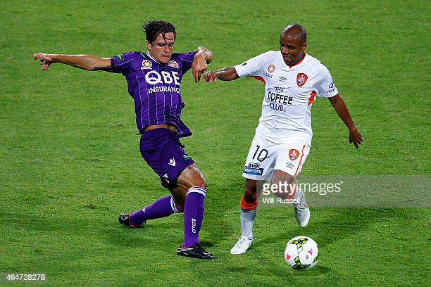 Joshua Risdon of the Glory and Henrique De SIlva of the Roar vie for the ball during the round 19 ALeague match between Perth Glory and Brisbane Roar...