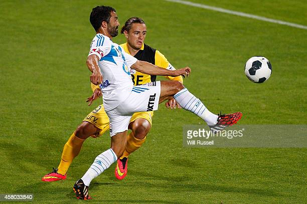 Joshua Risdon of the Glory challenges Fahid Ben Khalfallah of the Victoryfor the ball during the FFA Cup Quarter FInal match between the Perth Glory...