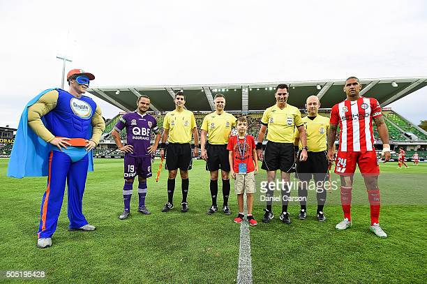 Joshua Risdon of the Perth Glory and Patrick Kisnorbo of the Melbourne City FC line up for the coin toss during the round 15 ALeague match between...