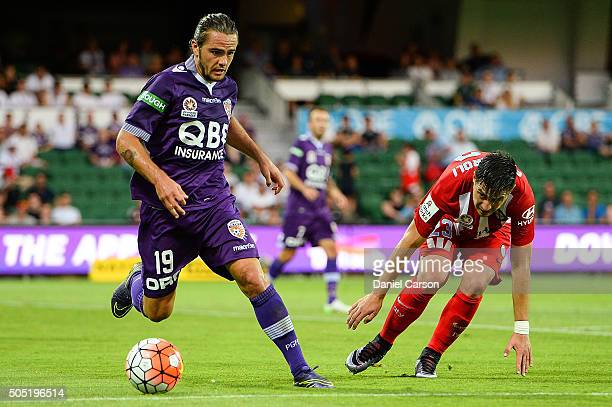 Joshua Risdon of the Perth Glory gets past Bruno Fornaroli of the Melbourne City FC during the round 15 ALeague match between Perth Glory and...