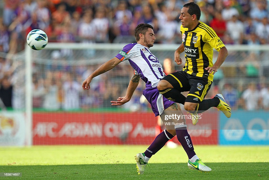 Joshua Risdon of the Perth Glory tackles Leo Bertos of the Wellington Phoenix during the round 25 A-League match between the Perth Glory and the Wellington Phoenix at nib Stadium on March 17, 2013 in Perth, Australia.