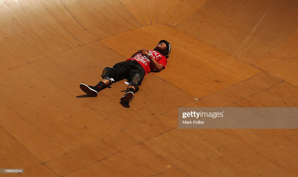 Joshua Rodriguez of the USA reacts after missing a landing in the Beach Bowl skateboarding competition during the 2012 Australian Surfing Open on February 19, 2012 in Manly, Australia.