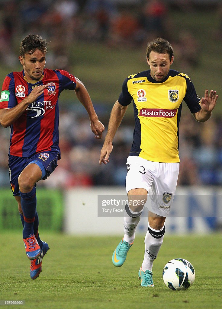 Joshua Rose of the Mariners contests he ball with his Jets opponent during the round ten A-League match between the Newcastle Jets and the Central Coast Mariners at Hunter Stadium on December 8, 2012 in Newcastle, Australia.