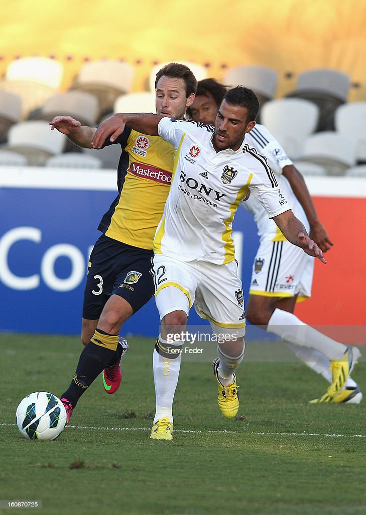 Joshua Rose of the Mariners is pressured by Emmanuel Muscat of the Phoenix during the round 20 A-League match between the Central Coast Mariners and the Wellington Phoenix at Bluetongue Stadium on February 7, 2013 in Gosford, Australia.