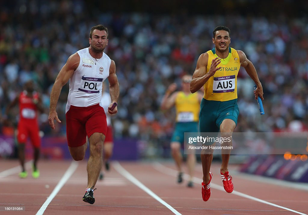 Joshua Ross of Australia and Kamil Krynski of Poland compete in the Men's 4 x 100m Relay Round 1 heats on Day 14 of the London 2012 Olympic Games at Olympic Stadium on August 10, 2012 in London, England.