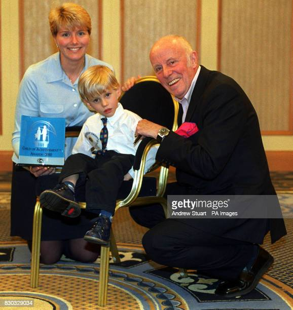 Joshua Russell from Norfolk with his mother Lisa Russell and actor Richard Wilson Joshua was one of 150 children to receive a Millennium Child of...