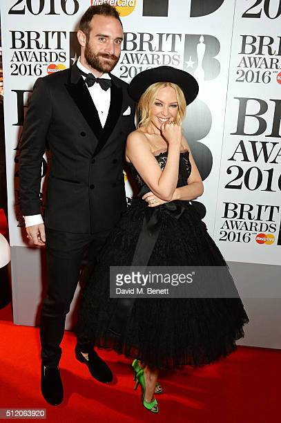 Joshua Sasse and Kylie Minogue arrive the BRIT Awards 2016 at The O2 Arena on February 24 2016 in London England