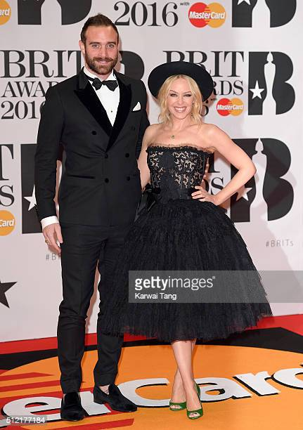 Joshua Sasse and Kylie Minogue attend the BRIT Awards 2016 at The O2 Arena on February 24 2016 in London England