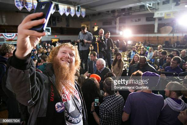STATES JANUARY 24 Joshua Sears of Waterloo takes a selfie with Democratic presidential candidate Sen Bernie Sanders in the background after an event...