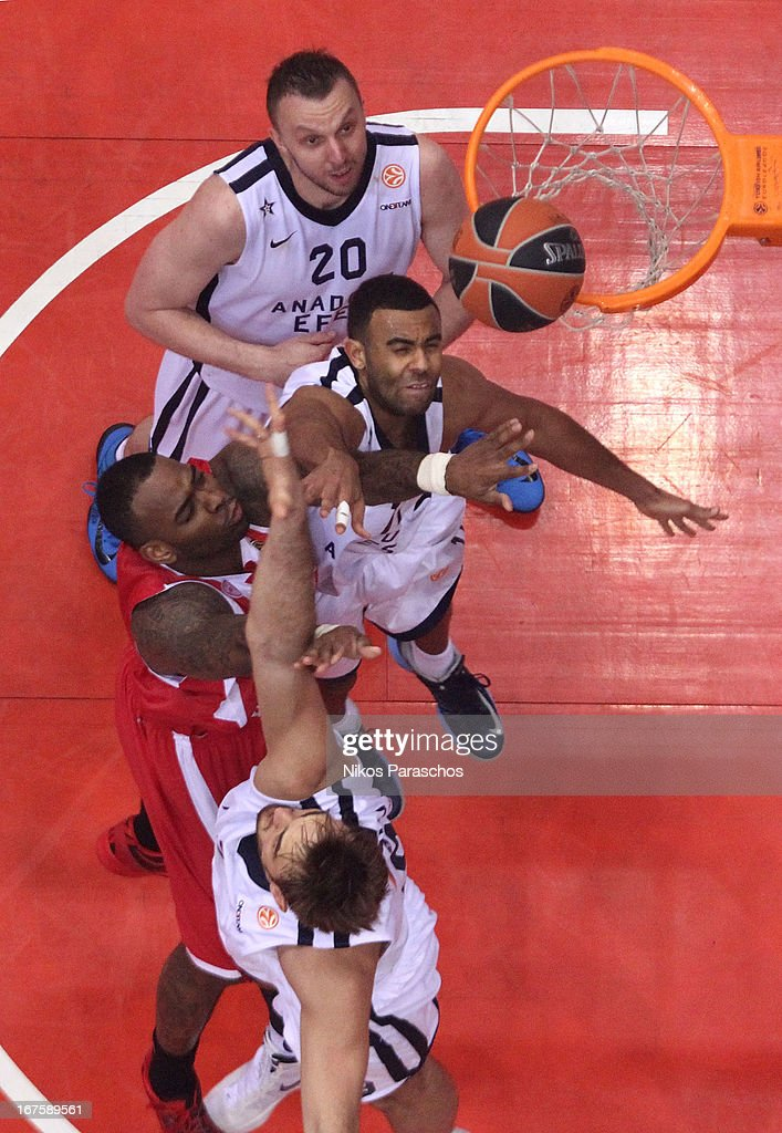 Joshua Shipp, #11 of Anadolu Efes Istanbul competes with <a gi-track='captionPersonalityLinkClicked' href=/galleries/search?phrase=Acie+Law&family=editorial&specificpeople=801584 ng-click='$event.stopPropagation()'>Acie Law</a>, #5 of Olympiacos Piraeus during the Turkish Airlines Euroleague 2012-2013 Play Offs game 5 between Olympiacos Piraeus v Anadolu Efes Istanbul at Peace and Friendship Stadium on April 26, 2013 in Athens, Greece.