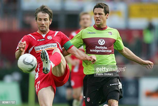 Joshua Simpson of Kaiserslautern battles for the ball with Marco Rose of Mainz during the Second Bundesliga match between FSV Mainz 05 and 1 FC...