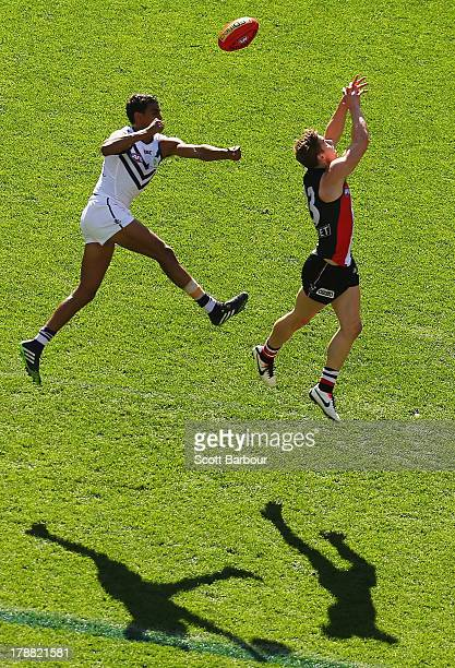 Joshua Simpson of the Dockers and Tom Curren of the Saints compete for the ball during the round 23 AFL match between the St Kilda Saints and the...