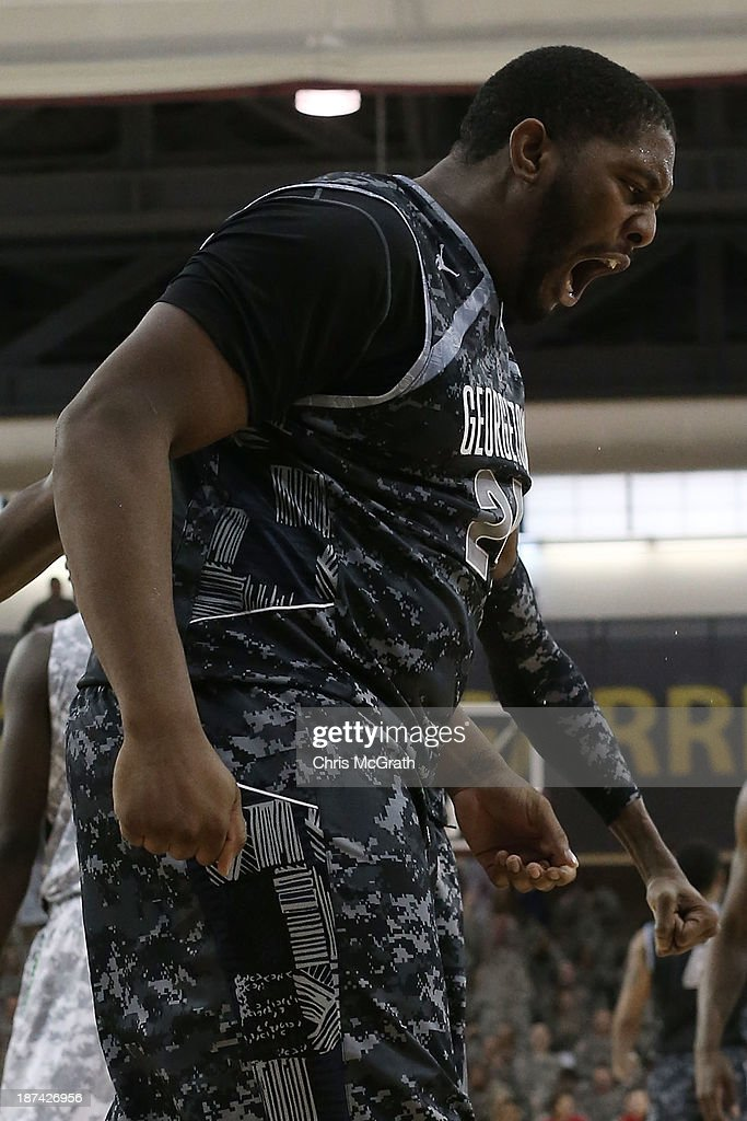 Joshua Smith of the Georgetown Hoyas celebrates a slam dunk against the Oregon Ducks during the Armed Forces Classic at United States Army...