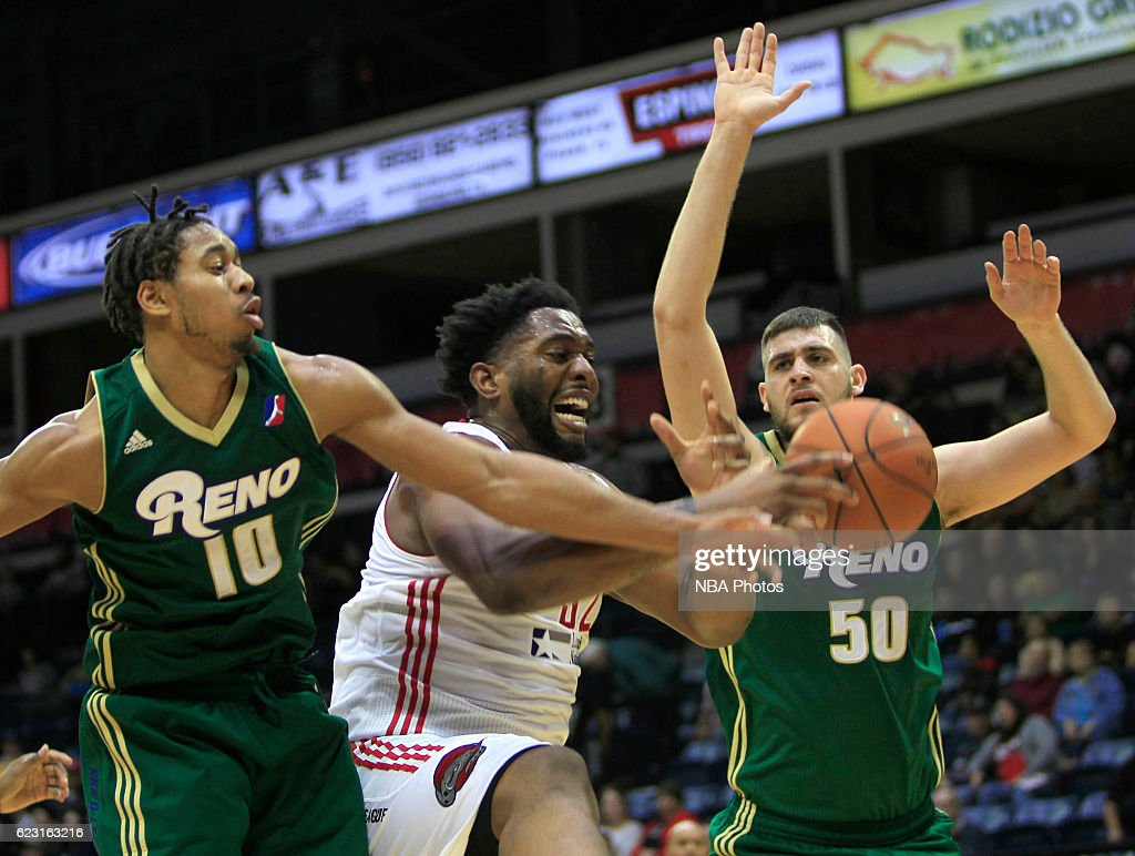 Joshua Smith of the Rio Grande Valley Vipers, center, fights for a loose ball between Isaiah Cousins, left, and Georgios Papagiannis of the Reno Bighorns at the State Farm Arena November 13, 2016 in Hidalgo, Texas. User expressly acknowledges and agrees that, by downloading and/or using this Photograph, user is consenting to the terms and conditions of the Getty Images License Agreement. Mandatory Copyright Notice: Copyright 2016 NBAE