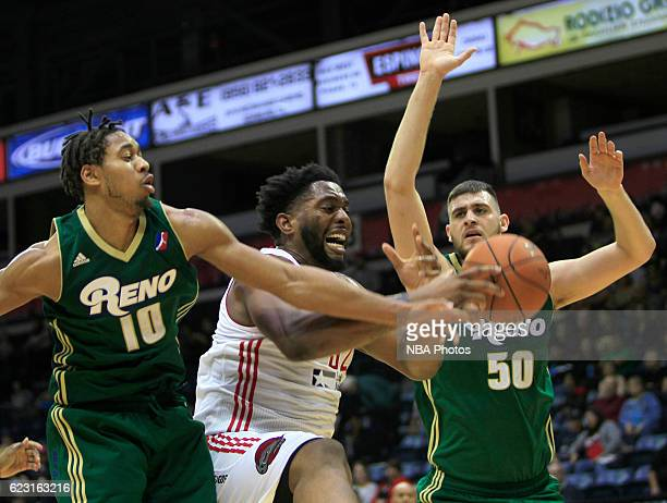 Joshua Smith of the Rio Grande Valley Vipers center fights for a loose ball between Isaiah Cousins left and Georgios Papagiannis of the Reno Bighorns...