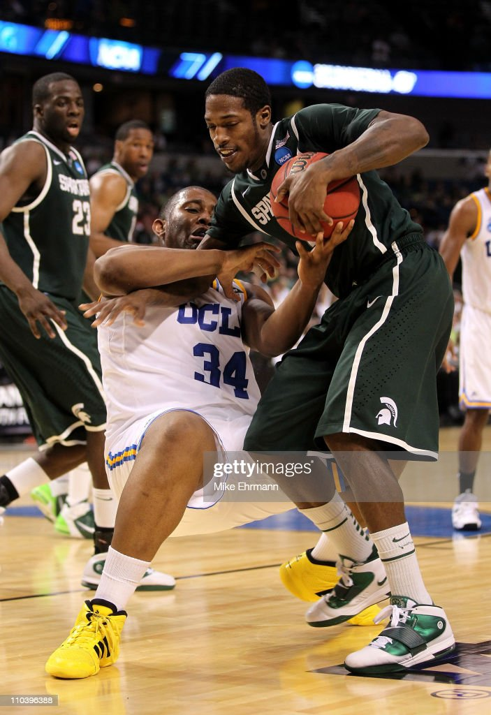 Joshua Smith #34 of the UCLA Bruins and Durrell Summers #15 of the Michigan State Spartans fight for the ball which results in a jumpball in the second half during the second round of the 2011 NCAA men's basketball tournament at St. Pete Times Forum on March 17, 2011 in Tampa, Florida.