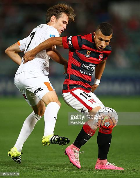 Joshua Sotirio of the Wanderers and Corona of the Roar contest possession during the round one ALeague match between the Western Sydney Wanderers and...