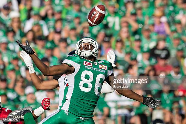 Joshua Stanford of the Saskatchewan Roughriders can't come down with the reception in the first half the game between the Calgary Stampeders and...