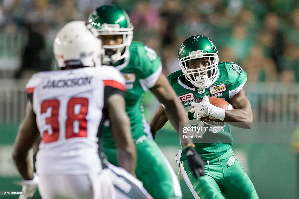 Joshua Stanford #86 of the Saskatchewan Roughriders runs with the ball in the game between the Ottawa Redblacks and the Saskatchewan Roughriders at Mosaic Stadium on July 22, 2016 in Regina, Canada.